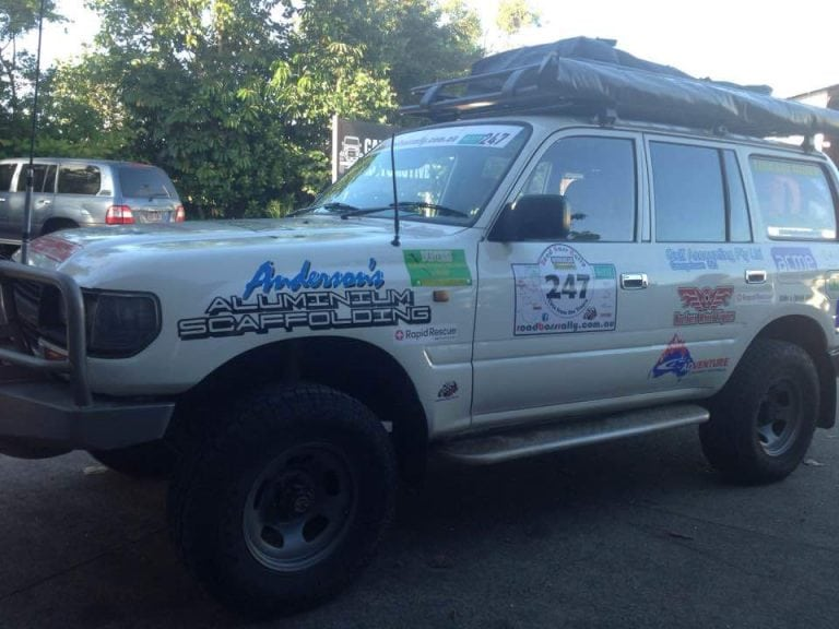 a suv car with sponsored by andersons scaffolding